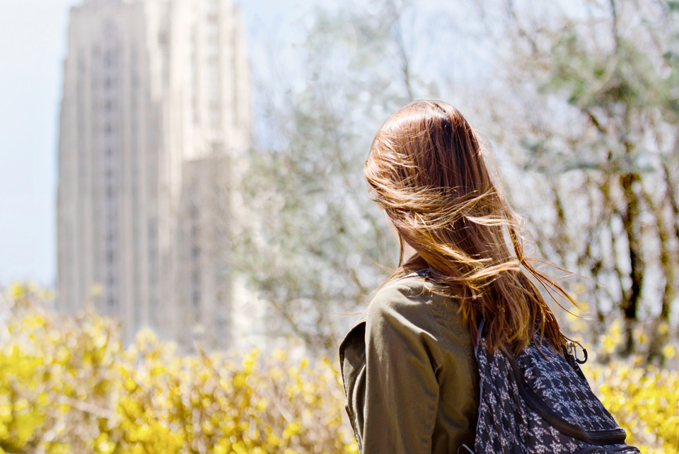 girl in front of cathedral of learning